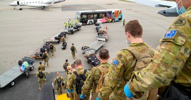 Soldiers from the 1st Battalion, Royal Australian Regiment, arrive at Perth Airport, Western Australia, to support quarantine compliance monitoring. Photo by Petty Officer Yuri Ramsey.