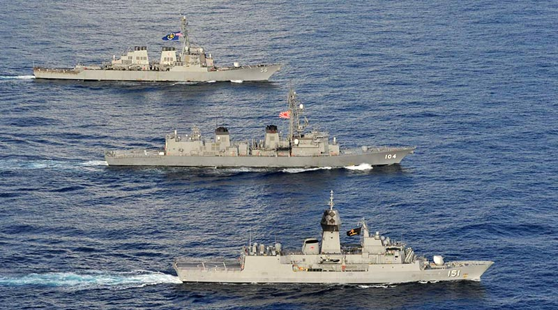 Arleigh Burke-class guided-missile destroyer USS John S. McCain, Japan Maritime Self-Defense Force JS Kirisame and HMAS Arunta in the South China Sea, 20 October 2020. Photographer unknown.