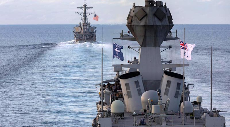 HMAS Ballarat sails with USS John S. McCain in the Strait of Malacca. Photo by Leading Seaman Shane Cameron.