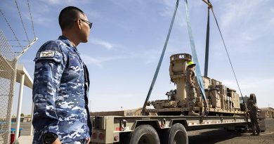 Detachment Commander Squadron Leader Kevin Lee oversees the removal of communications equipment at Camp McNamara in the Middle East before the Aussie base is handed back to the US Air Force. Photo by Corporal Tristan Kennedy.