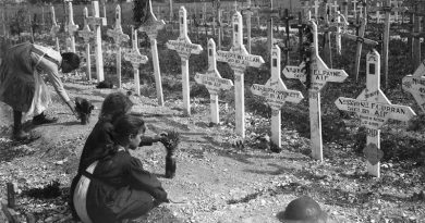French children tend the graves of Australians killed in battle on the Western Front. AWM E05925