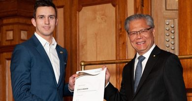 CSGT Austin Arnold receives his Gold Award certificate at Adelaide Town Hall from Governor of South Australia Hieu Van Le. Image courtesy of The Duke of Edinburgh's International Award – South Australia.