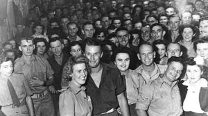 Members of HQ 7 Division and 7 Div Provost, packed in for a dance with members of the Australian Army Medical Women's Service, the Women's Land Army and civilians at the Koala Club on 15 November 1944. Photo from Australian War Memorial (083186).