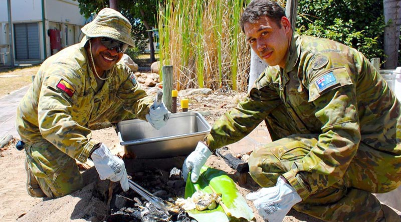 No. 2 Security Forces Squadron Airfield Defence Guard Leading Aircraftman Pryce Mareko, left, and 5 Aviation Regiment life-support fitter Craftsman Christopher Morganson at RAAF Base Townsville.
