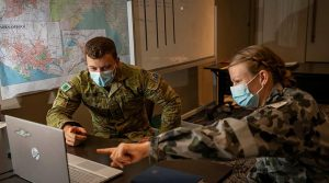 Lieutenant Jeremy Rooke, left, and Lieutenant Tracey Magyar analyse data during Operation COVID-19 Assist in Victoria. Photo by Corporal Daniel Strutt.