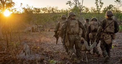 US Marines and sailors with Ground Combat Element, MRF-D, engage in casualty evacuation drills during Exercise Koolendong in Northern Territory, Australia. US Marine Corps photo by Corporal Sarah Marshall.
