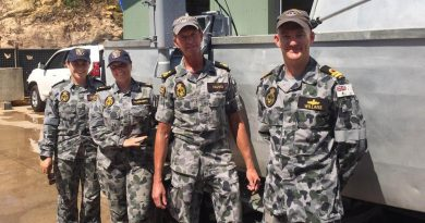Able Seaman Deneki Stewart, Leading Seaman Tanya Maksimovic, Petty Officer David Neaves and Lieutenant Jared Willans with the fly-away survey equipment they used to find a submerged Army watering hole.
