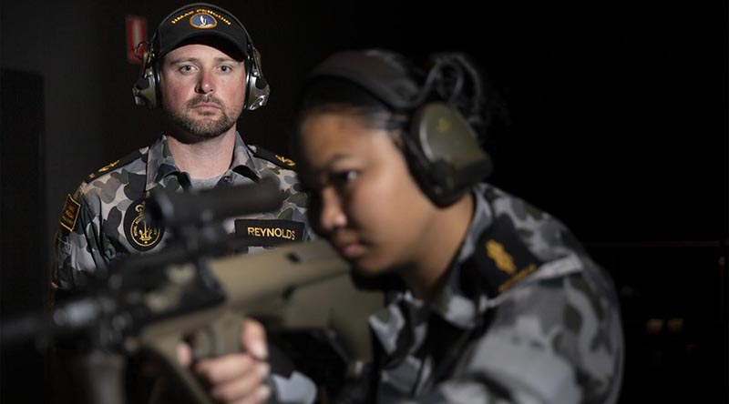 Leading Seaman Bradley Reynolds supervises Able Seaman Armilyn Pontanes during a live-fire serial at the new Weapons Training Simulation System at HMAS Penguin. Photo by Leading Seaman Nadav Harel.
