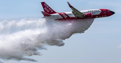 The NSW Rural Fire Service Boeing 737 large air tanker drops a load of water over RAAF Base Richmond. Photo by Corporal Dan Pinhorn.