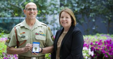 Warrant Officer Class 1 Rod Rootham with his wife Warrant Officer Class 2 Jo Rootham after receiving a Vice Chief of the Defence Force Gold Commendation in Canberra. Photo by Kym Smith.
