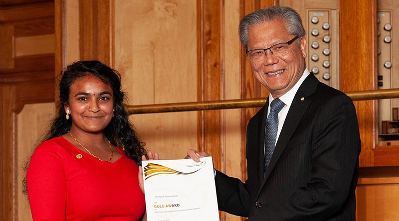 Tharane Thamodarar receives her Duke of Edinburgh's International Award Gold Award certificate at Adelaide Town Hall from Governor of South Australia Hieu Van Le. Image courtesy of The Duke of Edinburgh's International Award – South Australia.