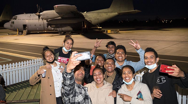 Timorese students happy to be boarding a Royal New Zealand Air Force C-130H Hercules for a flight home. NZDF photo.
