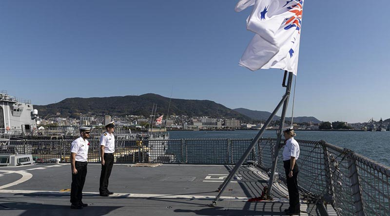 Members of HMAS Arunta's ship's company stand at attention during a Remembrance Day ceremony while alongside Sasebo Naval Base, Japan. Photo by Leading Seaman Jarrod Mulvihill.