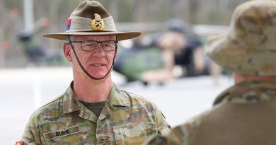 Chief of Army Lieutenant General Rick Burr talks to a soldier at Greenbank Training Area, Queensland. Photo by Corporal Colin Dadd.