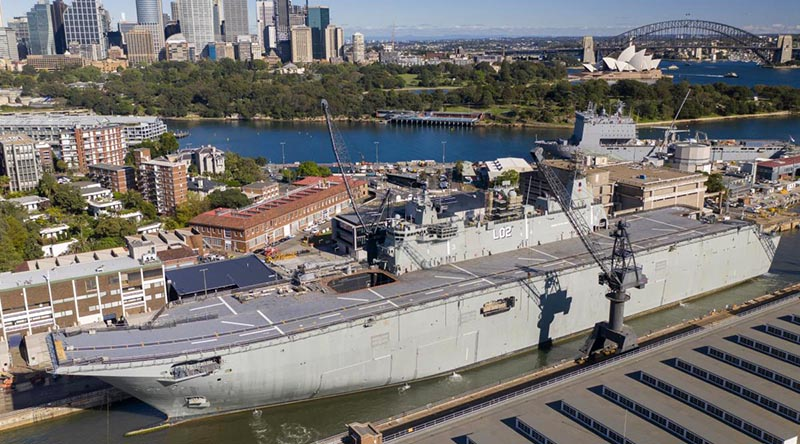 HMAS Canberra enters the Captain Cook Graving Dock at Garden Island, Sydney. Photo by Chief Petty Officer Kelvin Hockey.