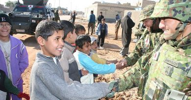 Iraqi children shake hands with JGSDF soldiers during a reconstruction operation. Photo by Rikujojieitai Boueisho, via WikiCommons.