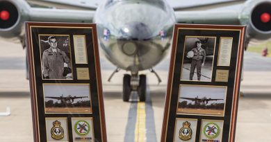 Framed commemorations of Flying Officer Michael Herbert and Pilot Officer Robert Carver positioned in front of a Canberra bomber during a 50th anniversary commemorative service at RAAF Base Williamtown. Photo by Corporal Brett Sherriff.