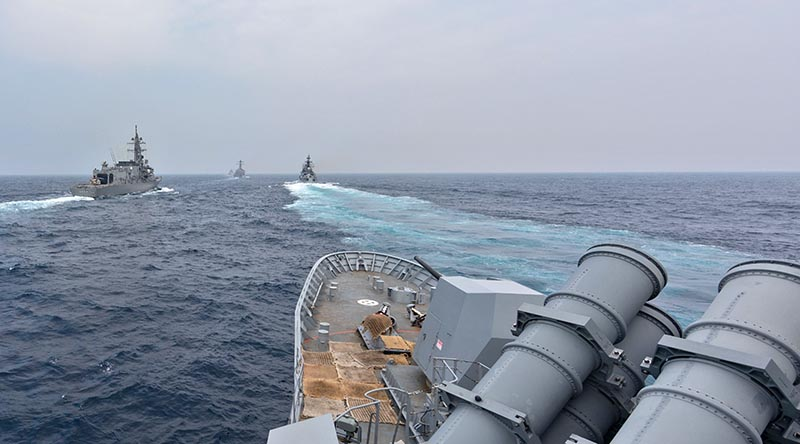 HMAS Ballarat conducts maritime manoeuvres with ships from the Japanese, Indian and United States navies during Exercise Malabar 2020. Photo by Leading Seaman Shane Cameron.