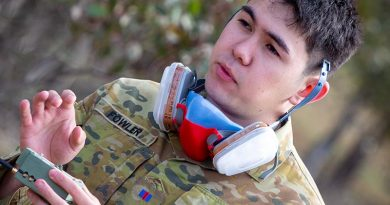 Army Staff Cadet Oscar Fowler from the Royal Military College Duntroon explains his prototype chemical-threats sensor. Photographer unnamed.