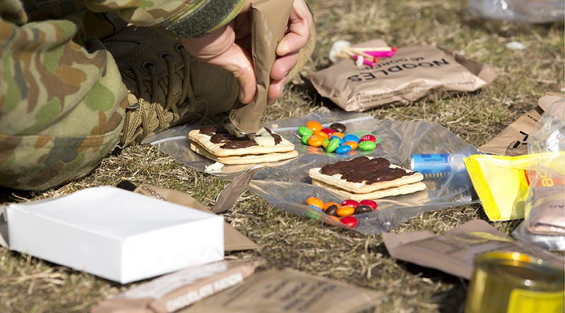 An Australian Army staff cadet from Royal Military College, Duntroon, combines ingredients during a lecture on ration packs at the Majura training area. Photo by Sergeant Bill Solomou.