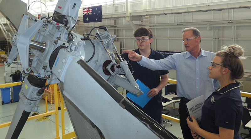Sikorsky Australia's apprentice aircraft maintenance engineer students Corey Plummer (left) and Nicola Douet receive instruction from Tony Intihar as during their aircraft maintenance training at Sikorsky Australia. Image supplied.