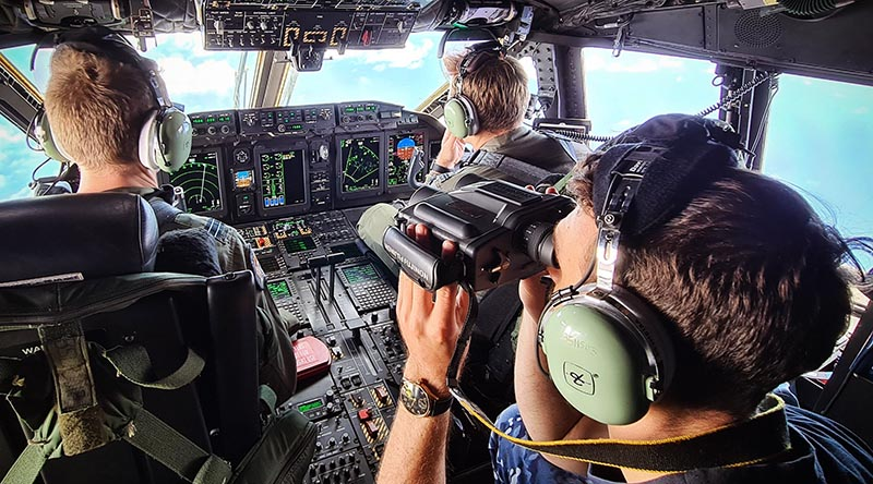 Crew on a RAAF C-27J Spartan scan south-west Pacific seascape for illegal fishing. Photographer unknown.