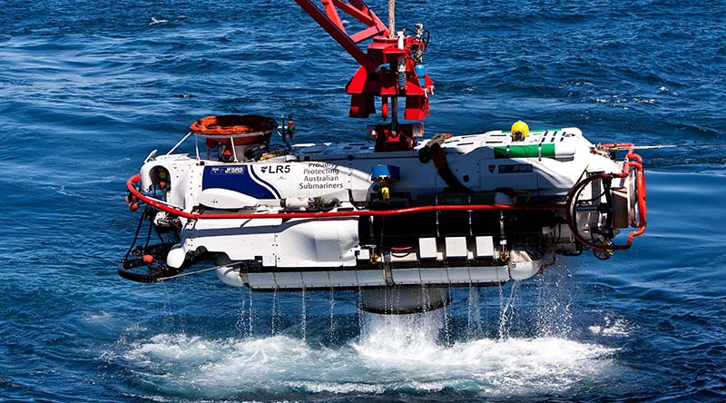 The LR5 submersible clears the water as it begins its recovery after a successful personnel transfer with HMAS Farncomb in the East Australian Exercise Area during Exercise Black Carillon 2013. Photo by Leading Seaman Brenton Freind.