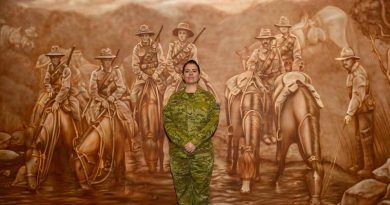 Lance Corporal Jessica Haines-Hann in front of the mural she painted at the Gallipoli Barracks Sergeants' Mess.