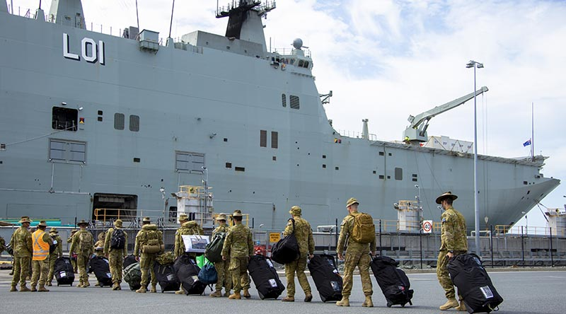 Australian Army soldiers from 6th, 7th, 16th and 17th Brigades board HMAS Adelaide at Port of Brisbane, before they deploy to Fiji tp provide humanitarian assistance and disaster relief. Photo by Corporal Dustin Anderson.