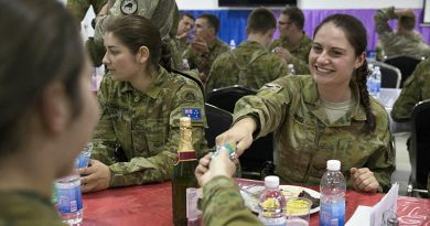 Australian Army Lance Corporal Ella Jones enjoying Christmas festivities at Taji Military Complex, Iraq. Photo by Corporal Steve Duncan.