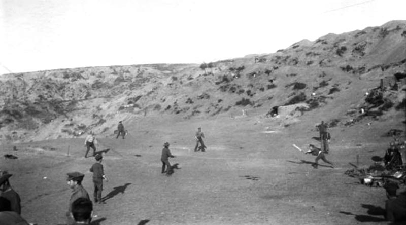 Major George Macarthur Onslow of the Light Horse plays and awkward ball and is caught out during a cricket match played on Shell Green, Gallipoli, as one of many distractions used to fool the Turks about the imminent withdrawal of allied troops. AWM G01289.