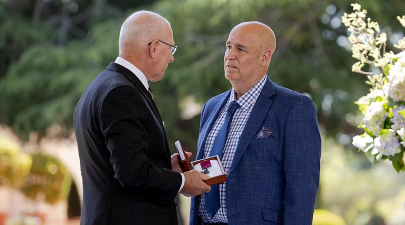 Governor-General of Australia General David Hurley says a few private words to Teddy Sheean's nephew Greg Ivory before officially handing over the Sheean VC. Photo from GG's Facebook page.