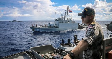 Lieutenant Bradley Chivers of HMAS Wollongong keeps watch during a coordinated maritime patrol in waters between Australia and Indonesia with KRI Pandrong and KRI Lemadang. Photographer unknown.