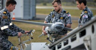 Members of the first Remote Pilot Warfare Officer course load a ScanEagle unmanned aircraft to the launcher before a flight at Jervis Bay Airfield. Photo by Chief Petty Officer Cameron Martin.