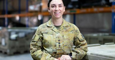 Captain Jess Law in the warehouse of the ADF's main operating base in the Middle East region. Photo by Corporal Tristan Kennedy.