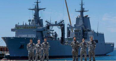 Marine technicians Able Seamen Greg Hallet, left, Cassandra Bullock, Mason Turner, Cody Martin, Yassi Coban and Leading Seaman Morse Stanton in front of NUSHIP Supply at Fleet Base West, Western Australia. Photo by Leading Seaman Ronnie Baltoft.
