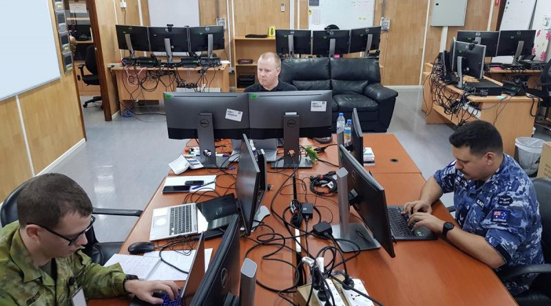 Corporal Mitchell Webster, left, Joel Palmer and Corporal Aaron Bartlett competing in the 2020 Cyber Warrior Challenge.