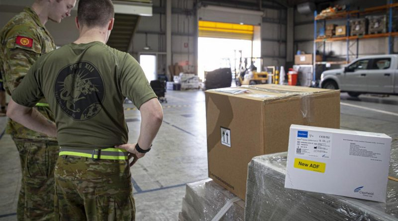 ADF personnel in the Middle East prepare a load of COVID-19 test kits for delivery to Afghanistan. Photo by Sergeant Ben Dempster.