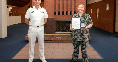 Captain Doug Theobald presents a Fleet Commander silver commendation to Able Seaman Sarah McDonald at an awards ceremony held at HMAS Stirling in Western Australia. Photo by Petty Officer Yuri Ramsey.