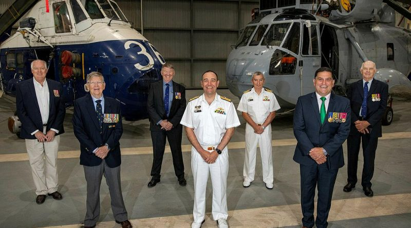 The first six recipients of the Australian Service Medal for Operation Bursa with the Commander Fleet Air Arm Commodore Don Dezentje, centre. Photo by Able Seaman Susan Mossop.