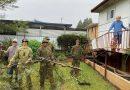 Soldiers blitz widow's backyard