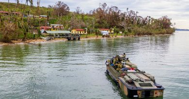 Soldiers from the 10th Force Support Battalion drive a light amphibious resupply cargo 5 onto the island of Galoa, in Fiji to drop off supplies required to repair buildings affected by Cyclone Yasa. Photo by Corporal Dustin Anderson.