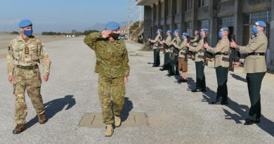 Major General Cheryl Pearce welcomed by an Honour Guard provided by the mission's Mobile Force Reserve.