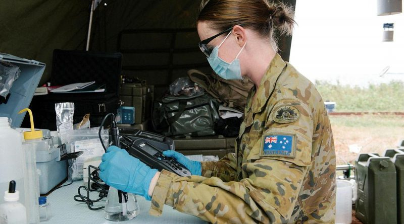 Captain Nicole Eltringham tests water from a desalination system in Vanua Levu on Operation Fiji Assist. Photo by Lieutenant Phillip Qin.