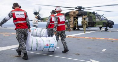 HMAS Adelaide sailors load disaster-relief supplies onto a MRH-90 Taipan bound for Nabouwalu on the island of Vanua Levu, Fiji, during Operation Fiji Assist 20-21. Photo by Corporal Dustin Anderson.