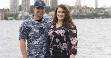 Leading Aircraftman Ryan Mills with his wife Ellen at Fleet Base East, Sydney.