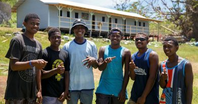 Island of Galoa locals in front of the Galoa Island Primary School repaired by Republic of Fiji Military Forces and ADF personnel from the 6th Engineer Support Regiment. Photo by Corporal Dustin Anderson.