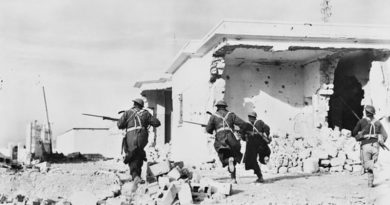 Australian soldiers enter the town of Bardia, Libia, on the second day of the Battle of Bardia. AWM006083 by unknown British official photographer.