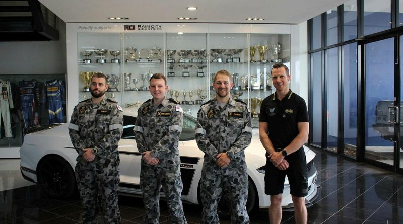 Leading Seaman Damien Smith, left, Able Seaman Nathan Steynberg, Leading Seaman Phillip Cowan and Matthew Roberts at Tickford Racing's headquarters in Melbourne.