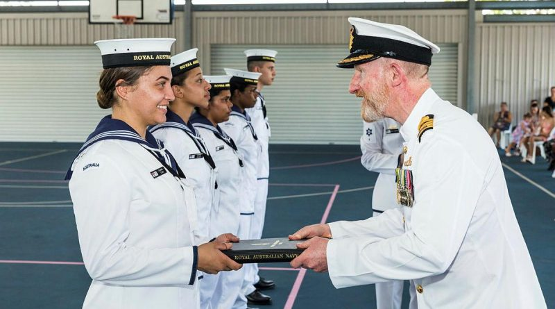 Captain Warren Bairstow congratulates Navy Indigenous Development Program graduate Recruit Chanika Stack at HMAS Cairns. Photo by Andrew Watson.